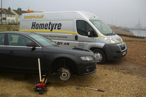 Audi tyres being fitted on Shoreham beach.