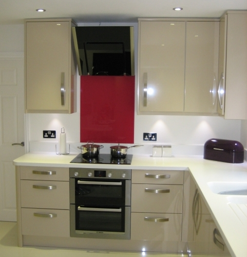Gloss Sand Beige Kitchen with Corian worktops and Neff appliances for Mr and Mrs Ironside