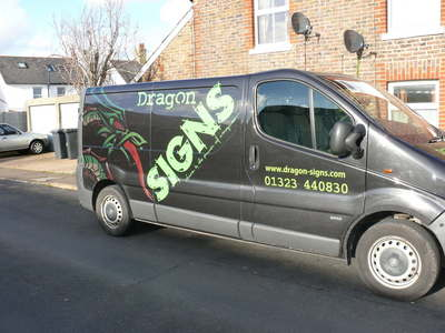 our very own van, mainly cut vinyl with a very experimental dragons - solvent inks digitally printed onto a top of the range black reflective film, in the sunlight or with a camera flash it lights up, in normal light it's very subtle, almost like a hologr