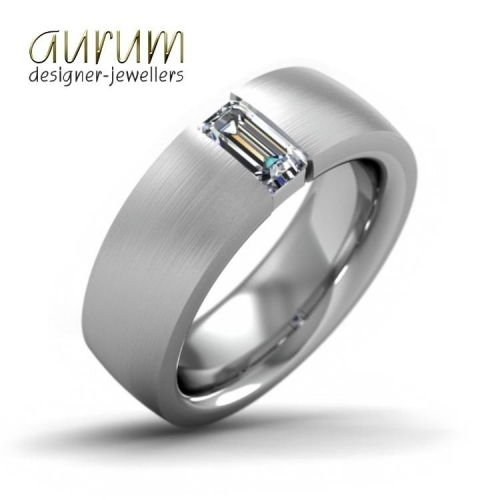 Wide platinum wedding ring with an emerald-cut diamond