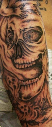 West Coast Tattoos' Black & Grey work by Blan. Skull, smoke and demon sleeve.