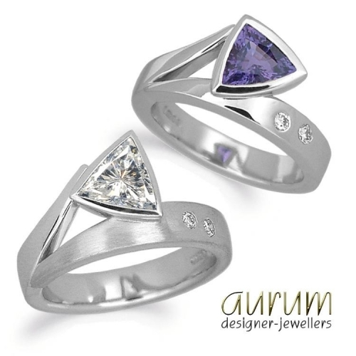 Flick engagement ring with trilliant diamond and sapphire