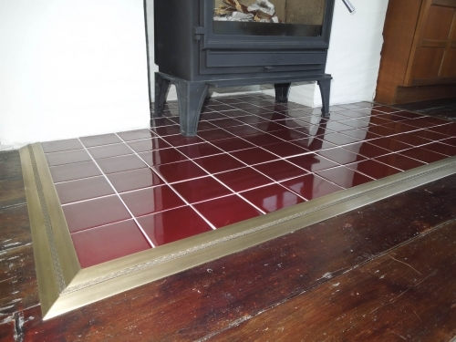 Hearth trim using Posh thresholds available from Carpetrunners.co.uk