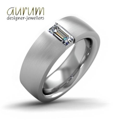 Wide platinum wedding ring with an emerald-cut diamond